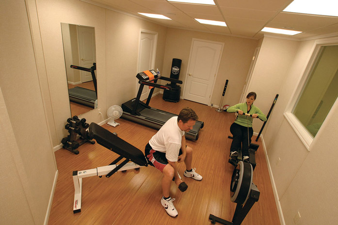 Home gym ideas designing a home gym in your finished basement for Basement workout room