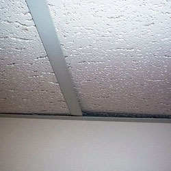 A sagging basement ceiling tile system
