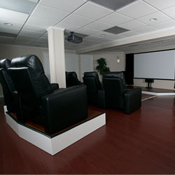 A home theater system installed in a finished basement.