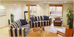 Create A new living room space with a finished basement